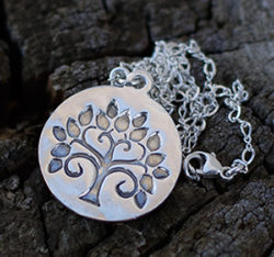 "This beautiful tree of life silver necklace has a statement medallionas a charm that has been made by hand to create its organic look.The tree of life represents as mentioned in the books of Genesis and Revelation, is a life-giving tree created to enhance and perpetually sustain the physical life of humanityThe sterling silver tree of life necklace will be a beautiful present for someone special that will keep it close to her heart. The necklace is made of fine silver and has a hand stamped charm bar that is mounted on an elegant silver chain. The silver bar charm measures approximately 7/8"" diameter"